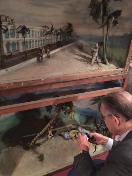 Ian McClure photographs one of the twenty remaining dioramas from the 1940 Negro Exposition.