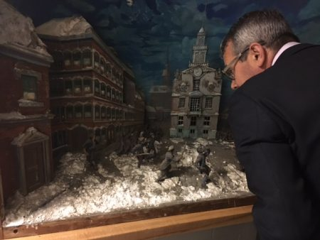 Paul Messier views the diorama depicting The Boston Massacre.